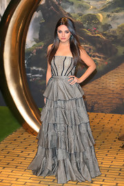 Mila Kunis opted for a fun and flirty tiered ruffle dress with a bit of a modern edge.