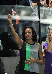 Michelle Obama was casual yet chic in a multicolored tank top with peekaboo detailing while watching the Olympic swimming team.