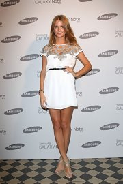 Millie Mackintosh flaunted her tanned legs wearing a Ruby Ray London minidress during the Samsung Galaxy launch party held in London.