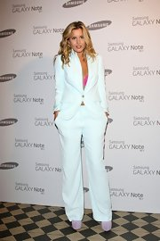 Caggie Dunlop was in an all-white suit at the Samsung Galaxy party.
