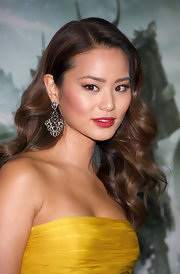 Actress Jaime Chung paired her strapless canary gown with silver chandelier earrings.