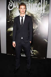Max Irons looked sharp at the premiere of 'Sucker Punch' in a classic black suit. A white button down shirt and black tie completed his look.