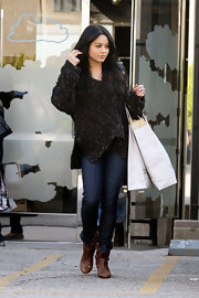 Vanessa Hudgens went shopping in a pair of dark denim skinny jeans.