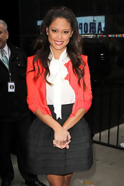 To add pop to her look on 'Good Morning America,' Vanessa Lachey layered a coral blazer over an on trend tie-neck blouse.