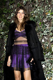 Michelle kept warm in her sheer dress with a thick shearing coat over her shoulders at the Chateau Marmont.