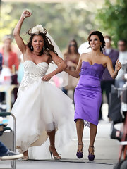 Eva Longoria ran on set in this lacy purple bridesmaid dress.