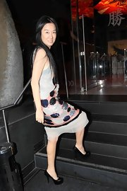 The famed designer grabbed a bite at the popular sushi restaurant wearing a sequined dress and a pair of black leather, platform pumps.