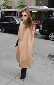Victoria stepped out in style when she sported this super contemporary tan coat.