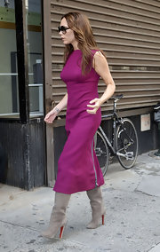 Victoria Beckham dazzled NYC in a mid-calf fuchsia shift and slouchy taupe boots.