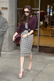 Victoria Beckham was picture perfect in NYC wearing an eggplant cardigan belted over a well-tailored pencil dress.
