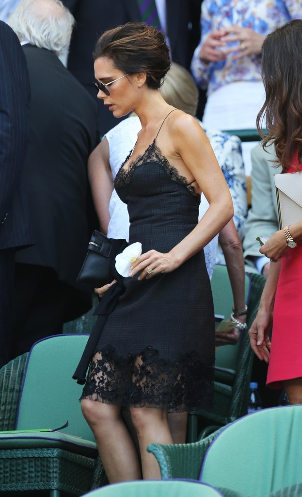 Victoria Beckham takes her seat in the Royal Box for the Men's Final at the Wimbledon Tennis Championships in London.