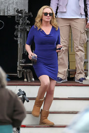 Virginia Madsen chose this royal purple fitted-dress with a cool cowl-neck while on set of the 'Hatfields & McCoys.'