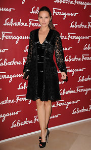 Virginie Ledoyen arrived for a Da Vinci exhibition at the Louvre wearing a pair of black satin peep toe pumps.