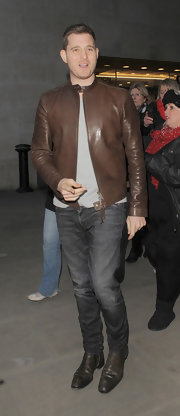 Michael Buble opted for black faded jeans while out in London.