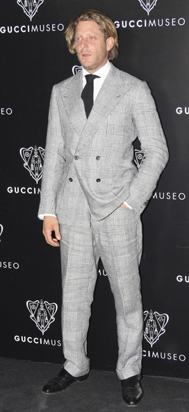 Lapo Elkann went for a traditional look with this patterned gray double-breasted suit at the opening of the Gucci Museum.