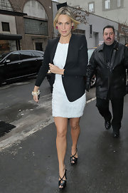 Molly is always a fixture at fashion Week and she looked as chic as ever in this white dress and black blazer. She topped her look off with a pair of peep-toe sandals.