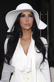 Kim Kardashian paired a shiny nude lipstick with her crisp white suit. Her lip color was blended with just the slightest hint of peach, perfectly complementing her skin tone.