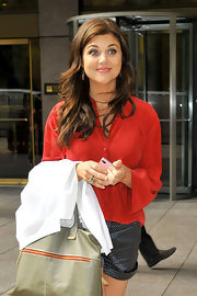 Tiffani Thiessen looked easy-breezy on the streets of New York City in a red button-down and pin-dot shorts.