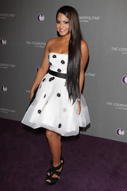Christina Milian paired her feminine party dress with black platform sandals with chiffon straps.