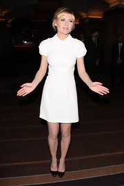 Kirsten Dunst paired her minimalist white dress with classic black pumps.