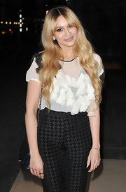 Zara Martin kept her pants ensemble feminine with a sheer floral-embellished blouse.