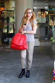 Whitney Port kept casual at California Pizza Kitchen in a pair of her favorite black ankle boots. The Western style buckled boots gave her low-key look an edge.