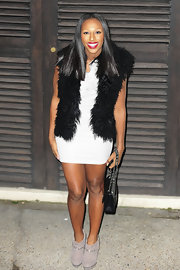 Alexandra Burke matched her dove gray ankle boots to her body con dress. The chain-trimmed suede boots were the perfect choice for Alexandra's exotic look.