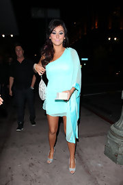Jenni wears a silky aqua cocktail dress with a dramatic one-sleeve design while out in Hollywood.