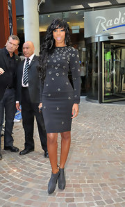 Kelly Rowland attended 'X Factor' auditions in a sexy black dress with stud detailing. She finished off the look with gray ankle boots.