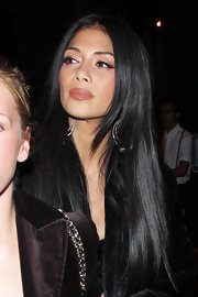 Nicole Scherzinger wore her raven tresses in long, shiny layers while out for an evening in LA.