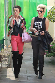 Cher paired her bubble gum pink pants with suede over-the-knee boots.