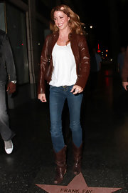 Actress Shannon Elizabeth showed off a stylish pair of brown cowboy boots while leaving Katsuya restaurant. She topped her leather look off with a brown zip-up jacket.