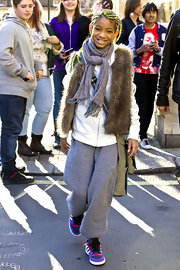 Willow wears a fur vest over her sweat suit for this eclectic look in London.