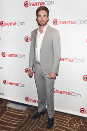 Chris Pine showed off his dapper style with this gray and white striped, peak-lapel, two-piece suit.
