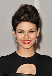 Victoria Justice wore her hair in a loosely wrapped bun atop her head for the 2012 BRIT Awards.