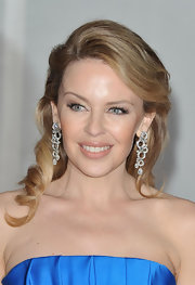 Kylie Minogue added a retro-inspired touch to her 'do with a deep side part and smooth glamour-girl curls for the 2012 BRIT Awards.