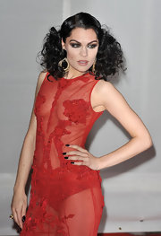 Jessie J. wore a pair of dangling lunar connection earrings at the 2012 BRIT Awards.