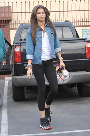 Zendaya Coleman sported a cool denim jacket over her white tee and leggins for a casual look while leaving 'Dancing With the Stars' rehearsals.