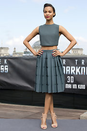 Zoe Saldana chose this gray crop top and matching skirt for her chic and contemporary look at the 'Star Trek' photocall in Berlin.