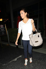 Eva Longoria dined out in cream canvas cutout boots with stiletto heels and tan leather crisscrossing ankle straps.