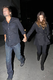 Kate Beckinsale kept warm in a black coat and black knee-high boots.