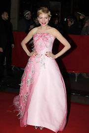 Michelle Williams was pretty in pink with this strapless dress with floral and bow embellishments.