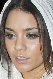 Vanessa Hudgens emphasized her eyes with glamorous metallic silver eyeshadow.