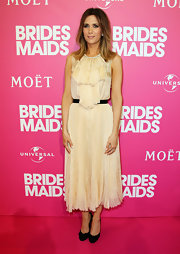 Kristen Wiig accented her creamy silk dress with black bow pumps.