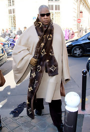 Andre wears a large fur Louis Vuitton scarf for Fashion Week in Paris.