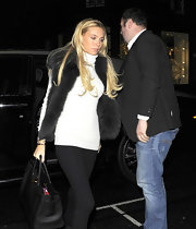 Petra Ecclestone looked ready for a winter wonderland in a white turtleneck and a chocolate fur vest.
