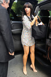 The actress wore a playful, sequined dress with nude, patent pumps.