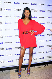 Jessica White struck a sultry pose at the Casio Tryx launch in suede periwinkle T-strap sandals and a long-sleeved red mini.