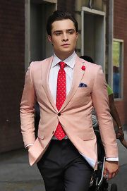 Ed paired his grey slacks with a salmon pink blazer.