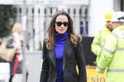 A demurely-dressed Pippa Middleton layers up as she heads to work at her London office.